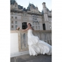 Winnipeg Photographer - Lloyd Rempel - bride at railing at Hotel Fort Garry - www.lrpv.ca